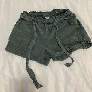 Paper-bag olive coloured shorts.